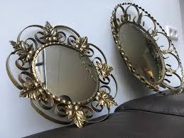 in style of deknudt wall mirror