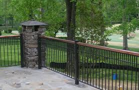 Black Wrought Iron Fence With Redwood Frame Custom Design Work Railing With Copper Accent And Stone Column Wrought Iron Fences Iron Fence Stone Columns