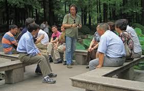 chinese people are communicating in park of Shanghai, China ...