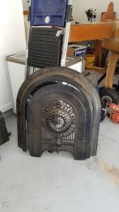 68 wide antique cast iron fireplace
