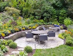 stone patio wall fire pit and garden