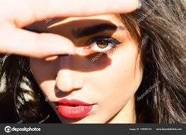 woman calm face makeup covers sunlight
