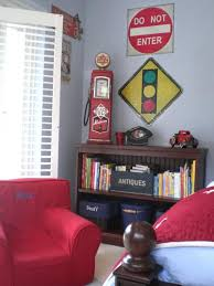 Antique Decor Lines The Bookshelf And Road Signs Hang From The Wall In An Automotive Themed Bedroom With Rich Re Big Boy Bedrooms Cars Room Car Themed Bedrooms