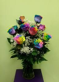 dozen rainbow roses arranged in