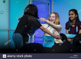 Melodie Loya, 13, from Bainbridge, New York, hugs her best friend. Phoebe  Smith, 12, from Aston, Pennsylvania, during the final round of the 2018  Scripps National Spelling Bee on May 31, 2018