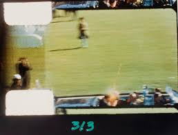 Frame 313 of 8mm home movie of assassination of John F. Kennedy, Dallas] |  International Center of Photography