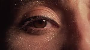 womans eye makeup closeup glitter