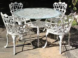 patio table with 4 arm chairs
