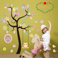 colorful tree decals with hanging owl