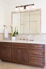 bathroom vanity with three panel mirror