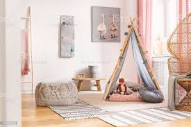 Patterned Pouf On Carpet Next To Tent With Cushions In White Kids Room Interior With Poster Real Photo Stock Photo Download Image Now Istock