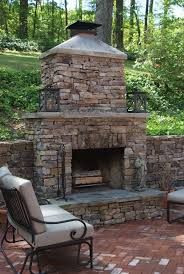 brick patio and outdoor stone fireplace