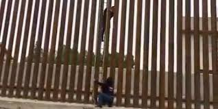Viral Video Shows People Using Ladder To Climb Us Mexico Border Fence Business Insider