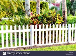 White Beach Wooden Wood Architecture Picket Fence Of House In Front Porch Yard Garden With Green Landscaping Trees Vacation Cottage Home Closeup Stock Photo Alamy