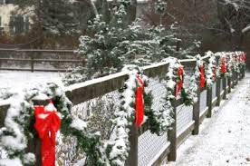 Fence Decorated With Bows And Garland For Christmas Outdoor Christmas Outside Christmas Decorations Outdoor Christmas Decorations