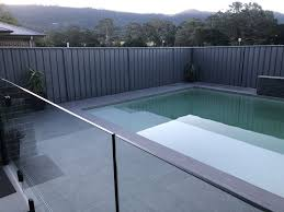 Grey Pool Tiles With Drop Edge Coping Glass Pool Fencing With Black Spigot In 2020 Glass Pool Fencing Pool Tile Pool Fence