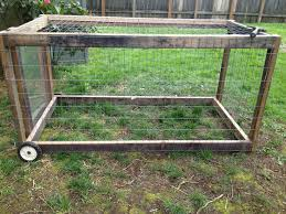 Cheap Portable Chicken Tractor Out Of Recycled Wood And Plexi Access Panel For Letting The Girls Move Ab Building A Chicken Coop Diy Chicken Coop Chicken Diy