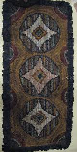 geometric hand hooked rug with images