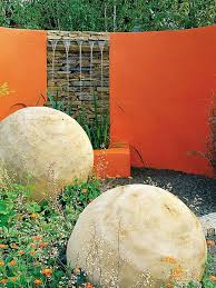 colorful wall helps to highlight garden