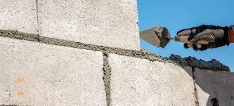 fix a cinder block retaining wall
