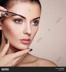 eyebrows beautiful woman face makeup