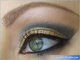 dramatic makeup look in black gold