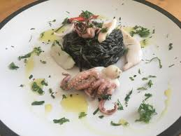 Cuttlefish ink rice and squids: have ...