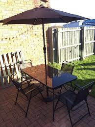 b q garden table with 6 foldable chairs