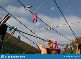 A Clothespin Hangs On The Washing Line A Rope With Clean Linen And Clothes Outdoors On The Day Of The Laundry Against The Stock Photo Image Of Background Hygiene 166307610