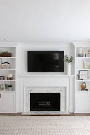 a white marble tile fireplace update