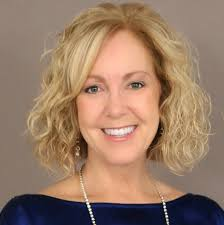 Laura Smith, VP Global Human Resources   DISYS