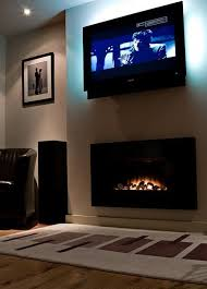 fancy electric fireplace tv above