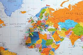 closeup of world map print pins flags