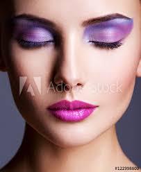 face closeup with purple eye make up