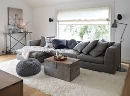 grey couch white rug living room grey