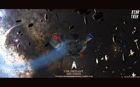 star trek uss defiant in field asteroid