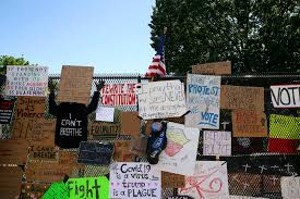 Donald Trump Put A Fence Around The White House To Keep People Away It Is Now Completely Covered In Protest Art
