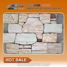 beige quartzite stacked stone fireplace