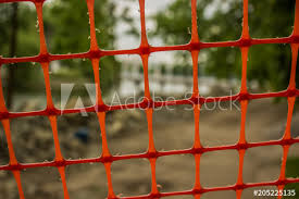 Soft Focus Orange Construction Fence With Colorful Unfocused Background Buy This Stock Photo And Explore Similar Images At Adobe Stock Adobe Stock