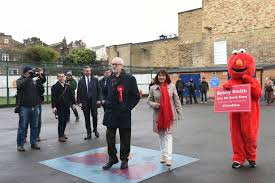 Jeremy Corbyn's visit to polling station gatecrashed by Elmo ...