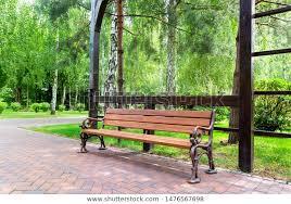 iron legs wooden seat board stock photo