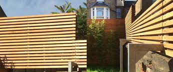 Western Red Cedar Premium Slatted Screen Boards Are Used To Create An Elegant Architectural Fence Silva Timber