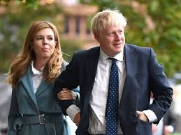 Boris Johnson and Carrie Symonds pictured with 11-week-old son Wilfred -  Insider