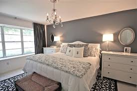 gray walls black and white bedding