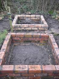 raised garden bed with bricks