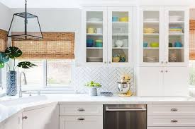pottery in glass front kitchen cabinets