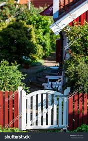 Small White Garden Gate Sided By Stock Photo Edit Now 714519421
