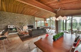 wood dining table stone accent wall