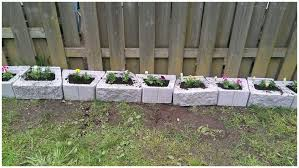 Dog Digging Under Fence Solutions 34904 I Used Concrete Blocks As Planters To Keep My Dog From In 2020 Diy Dog Fence Backyard Fences Dog Friendly Backyard