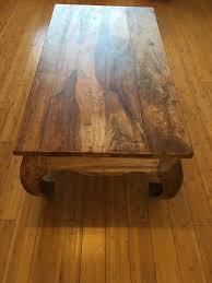 heavy wood coffee table balinese rose